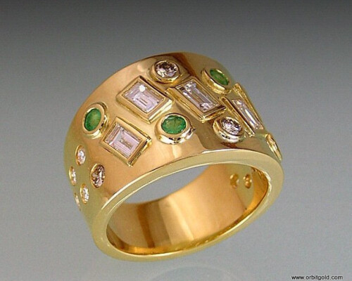 Emerald and Diamonds are set in a Harlequi design in wide modern ring