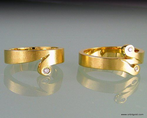 Rings with KORU design and diamonds