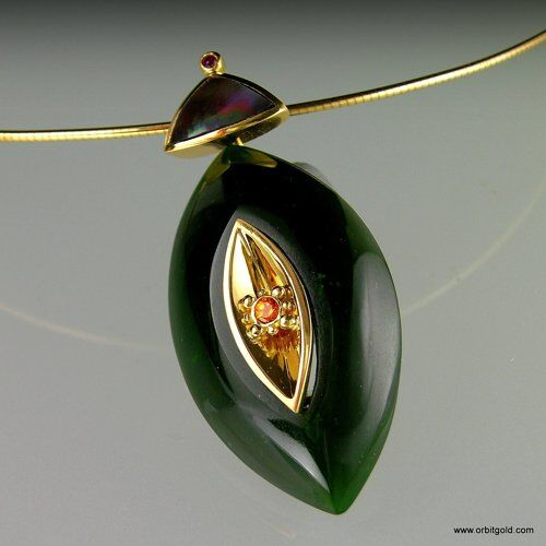 """Waka"" beautiful pendant crafted in Jade, gold, spessartite and ruby gemstones and mother of pearl"