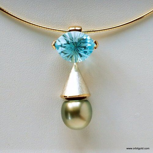 "Fancy cut Topazgemstone in ""Eye"" pendant with Tahitian pearl"