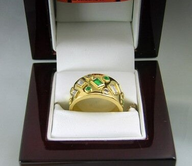 Emerald and diamond ring in box