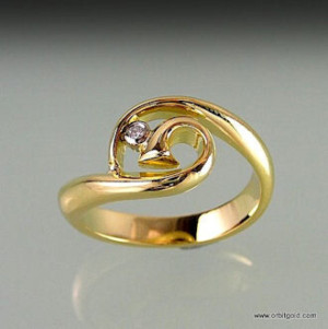 ring with a diamond in fern-like center