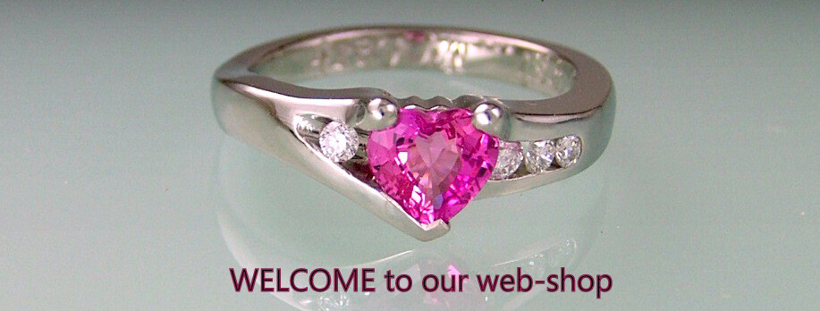 Pink sapphire heart ring in platinum