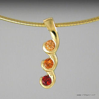 cascading gemstones pendant in yellowgold