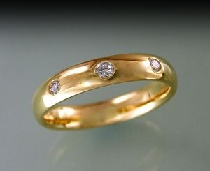 Re-modelled wedding ring with flush-set diamonds