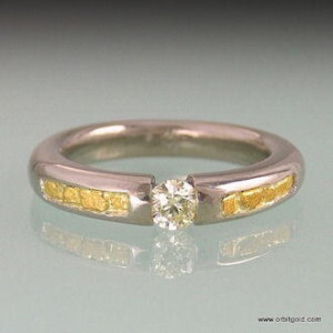 Whitegold ring with pressure set diamond and alluvial gold flakes